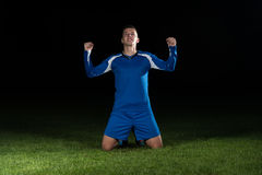 Soccer Player Celebrating The Victory On Black Background Stock Photos