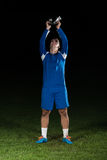 Soccer Player Celebrating Victory While Holding Win Coup Royalty Free Stock Photography
