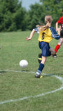 Soccer Player Chasing Ball 4. Girl soccer players chasing ball during game play Royalty Free Stock Photo