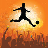Soccer player with cheering fans Stock Photo