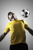 Soccer Player Chest Bumping a Ball Royalty Free Stock Images