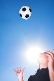 Soccer player or coach and bal stock image