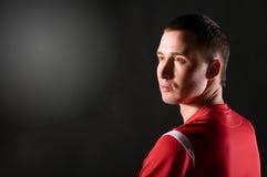 Soccer player in dark Stock Photo