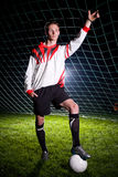Soccer player in the dark Royalty Free Stock Photo