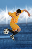 Soccer Player Doing Back Kick Stock Images