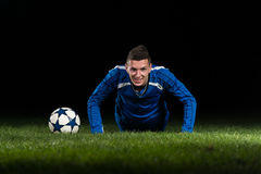 Soccer Player Doing Pushups Stock Photo