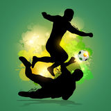 Soccer player dribbles through goalkeeper. With colorfu lsplatter background Royalty Free Stock Image
