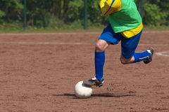 Soccer player dribbling Royalty Free Stock Photo