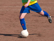 Soccer player dribbling Royalty Free Stock Images