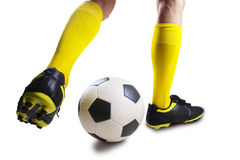 Soccer player dribbling the ball Stock Photos
