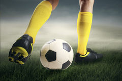 Soccer player dribbling the ball at field Royalty Free Stock Photo