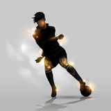 Soccer player dribbling with ball Stock Photography