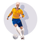 Soccer player dribbling a ball Royalty Free Stock Photos