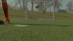 Soccer player executing penalty kick during training stock video