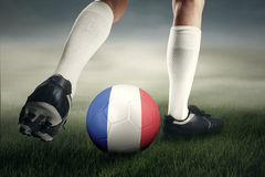 Soccer player exercises with ball at field Royalty Free Stock Photo