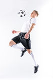 Soccer player exercising with ball Stock Images