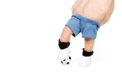 Soccer player feet stepping onto soccer ball Royalty Free Stock Image