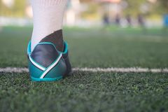 soccer player foot on the side of the pitch Stock Photo
