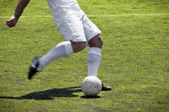 Soccer player free kick. White Soccer play in free kick action Stock Photos