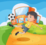 A soccer player in front of the school building Royalty Free Stock Photography