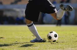 Soccer player goalkeeper kick the ball during football match. Soccer player kick the ball during football match Royalty Free Stock Photo