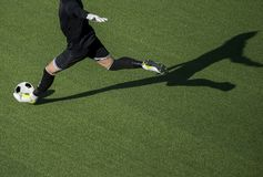 Soccer player goalkeeper kick the ball during football match.  Royalty Free Stock Image