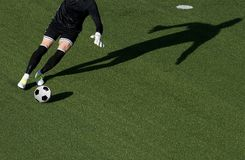 Soccer player goalkeeper kick the ball during football match.  Stock Photo
