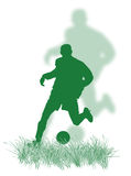Soccer player on the grass Royalty Free Stock Photography