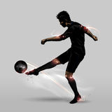 Soccer player half volley Stock Images