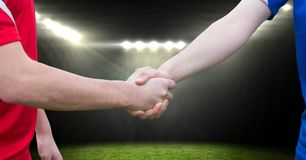 soccer player handshake in the field Royalty Free Stock Photo
