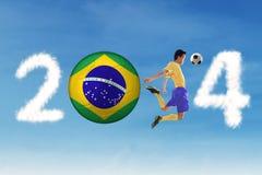 Soccer player heading the ball. A Brazilian football player heading the ball in the air royalty free stock image