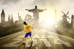 Soccer player heading the ball to brazil Stock Photo