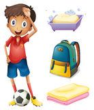 A soccer player with his backpack and bathroom stuffs Stock Images