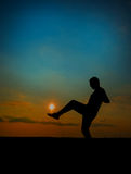 Soccer player hiting the sun. Soccer player hits the sun. sillouette Stock Photo