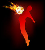 Soccer player hold ball fire on the chest Royalty Free Stock Photography