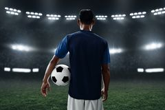 Soccer player hold soccer ball. Soccer player holding soccer ball royalty free stock photo