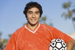Soccer player holding ball Royalty Free Stock Photography