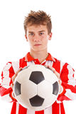 Soccer player holding a ball Royalty Free Stock Photography