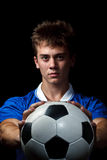 Soccer player is holding ball Royalty Free Stock Photography