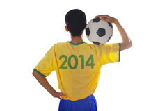 Soccer player holding ball isolated Stock Image