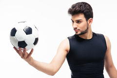 Soccer player holding ball Stock Photography