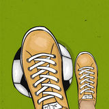 Soccer player holding foot ball on the green lawn of a football field. The sports poster. Vector Royalty Free Stock Photos