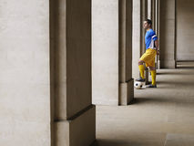 Soccer Player Holding Foot On Ball In Portico Royalty Free Stock Photos
