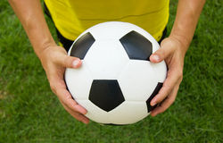 Soccer player holding a football. Royalty Free Stock Photography