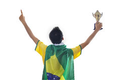 Soccer player holding trophy isolated Stock Image
