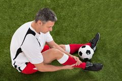 Soccer player with injury in leg Royalty Free Stock Photo