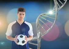 Soccer player with iron dna chain and lights background Royalty Free Stock Photos