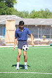 Soccer player juggle the ball  with his feet Royalty Free Stock Image