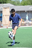 Soccer player juggle the ball  with his feet Stock Image