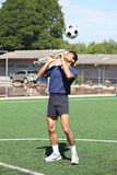 Soccer player juggle the ball  with his head Stock Image